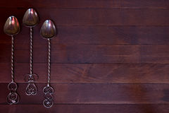 Silver teaspoon arranged over dark wooden table Stock Photography