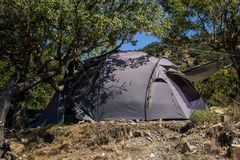 Silver Tent in the Green Bush on a Sunny Summer Day in the tourist camping. Silver Tent in the Green Bush on a Summer Day in the tourist camping, activity stock image