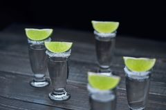 Silver tequila on a black wooden background Stock Photo