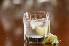 Silver tequila on the rocks Royalty Free Stock Images