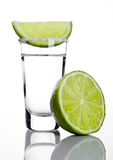 Silver tequila shot glass with lime slice and salt. On white background Royalty Free Stock Image
