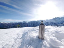 Silver thermos flask slope Royalty Free Stock Images