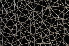 Silver threads weave. Chaotic weave of silver threads on black, abstract background Royalty Free Stock Photo