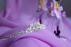 Silver tiara on purple decorations Royalty Free Stock Photography