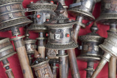 Silver Tibetan prayer wheels on stall at Swayambhu Stock Photos