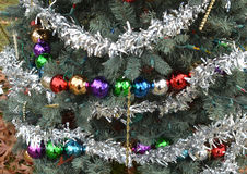 Silver tinsel garlands Christmas tree ball ornaments Royalty Free Stock Image