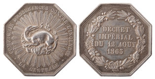 Silver token. Silvers token, Dragon with fire, Central Paris Insurance Company. France, the 3rd Republic, isolated on white Stock Photos