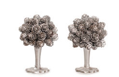 Silver topiary made from fir nob over white background Royalty Free Stock Photography