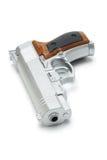 Silver toy gun. Silver color toy gun lying on white background Royalty Free Stock Photo