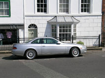 Silver Toyota Soarer. A rare classic Toyota Soarer parked in front of  house in Marlborough Royalty Free Stock Photo