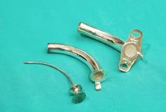 Silver tracheostomy tube Royalty Free Stock Photo