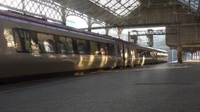 Silver train departing stock footage