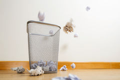 Silver trash bin and crumpled papers Stock Images
