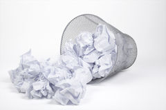 Silver trash bin and papers Royalty Free Stock Image