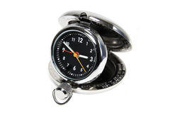 Silver travel clock. Silver pocket travel alarm clock isolated against white stock images