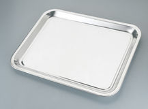 Silver tray. Silver serving tray on the plain background stock image