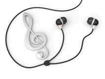 Silver treble clef and earphones Stock Photo