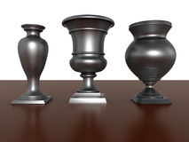 Silver trophies - awards. 3D render illustration of three silver trophies. The composition is positioned on a floor with a white horizontal background Royalty Free Stock Images