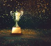 Silver trophy on abstract gold glitter background. Silver trophy on abstract gold glitter background stock image