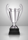 Silver trophy. Champion silver trophy over grey background royalty free stock images
