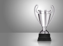 Silver trophy. Champion silver trophy over grey background stock photo