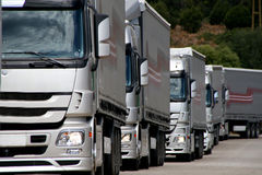 Silver trucks. Silver truck convoy approacing at viewer Stock Photo