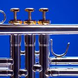 Silver Trumpet Isolated on Blue Stock Images