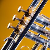 Silver Trumpet Isolated On Gold Royalty Free Stock Photo