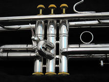 Silver Trumpet Valves. A side view of the valves of a Silver Trumpet Stock Image