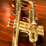 Silver Trumpet On Wood Stock Images