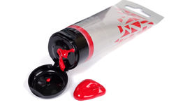 Silver tube of red paint Royalty Free Stock Photos