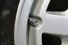 Silver tyre valve Stock Photos