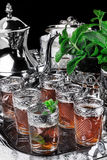 Silver urn with glasses on Moroccan mint tea Royalty Free Stock Images