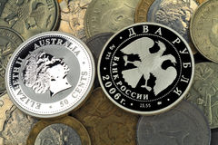 Silver and usual coins Stock Images