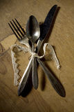 Silver utensils tide in lace ribbon Stock Image