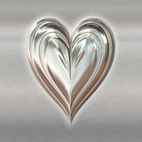 Silver valentines metal heart Stock Photography