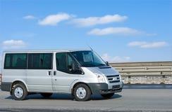 Silver Van On Road With Blue Horizon Stock Photos