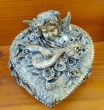 Silver victorian Cherub box. Silver jewellery etc victorian box with a cherub playing a musical instrument surrounded by roses Royalty Free Stock Images