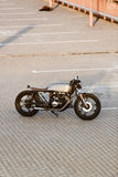 Silver vintage custom motorcycle cafe racer Stock Photos