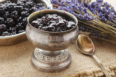 Silver vintage goblet of blackberry jam. Summer fruits Royalty Free Stock Photography