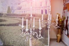 Silver vintage metal candlesticks on hall. Royalty Free Stock Photos