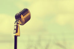 Silver vintage microphone in the studio on outdoor background. Sound royalty free stock photo