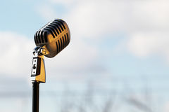 Silver vintage microphone in the studio on outdoor background. Sound royalty free stock photos