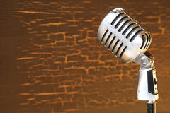 Silver vintage microphone in the studio on wood background Stock Photography