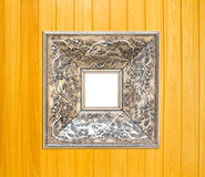 Silver Vintage picture frame on wood background Stock Photos