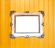 Silver Vintage picture frame on wood background Royalty Free Stock Photo
