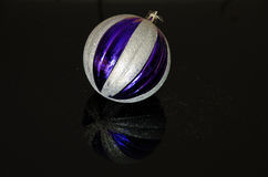 Silver and violet christmas bauble Stock Photo