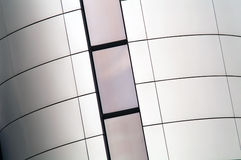 Silver wall. Silver building wall with windows Royalty Free Stock Photos