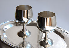 Silver ware. Cupronickel ware. Silver wine-glass stand on the tray stock image