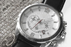 Silver watch on canvas Stock Images